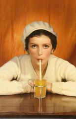 Woman in sweater and white beret drinking with a straw, by Egidio Scaioni