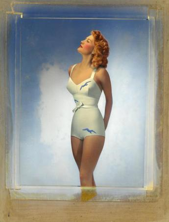 Woman in white swimsuit, sky blue seagull patterns, by Egidio Scaioni